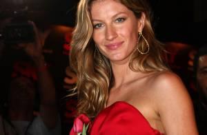 Gisele Bündchen moulée dans une robe de princesse rouge... les mots nous manquent !