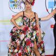 Cardi B (habillée d'une robe Dolce & Gabbana) à la soirée 2018 American Music Awards au Microsoft Theater à Los Angeles, le 9 octobre 2018.