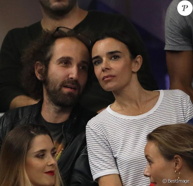 Elodie Bouchez et son mari Thomas Bangalter (groupe Daft Punk) dans les tribunes du stade de France lors du match de ligue des nations opposant la France à l'Allemagne à Saint-Denis, Seine Saint-Denis, France, le 16 octobre 2018.