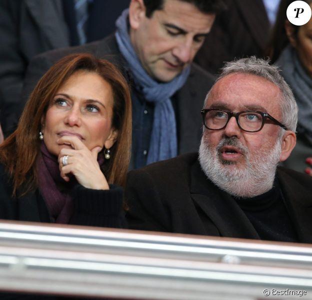 Dominique Farrugia et sa femme Isabelle - Huitième de finale retour entre le Paris Saint-Germain et le Bayer Leverkusen au Parc des Princes remporté par les parisiens sur le score de 2-1 à Paris le 12 mars 2014.
