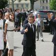 Michelle Obama, Carla et Nicolas Sarkozy et Barack Obama lors de la commémoration du Débarquement en Normandie le 6 juin 2009