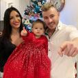 Julia Paredes, son chéri Maxime et leur fille Luna réunis pour leur premier Noël à trois, le 24 décembre 2018.