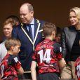 Le prince Albert II et la princesse Charlène de Monaco lors de la 9ème édition du Tournoi Sainte Dévote de Rugby au Stade Louis II à Monaco, le 11 mai 2019. © Jean-Charles Vinaj/Pool/Bestimage