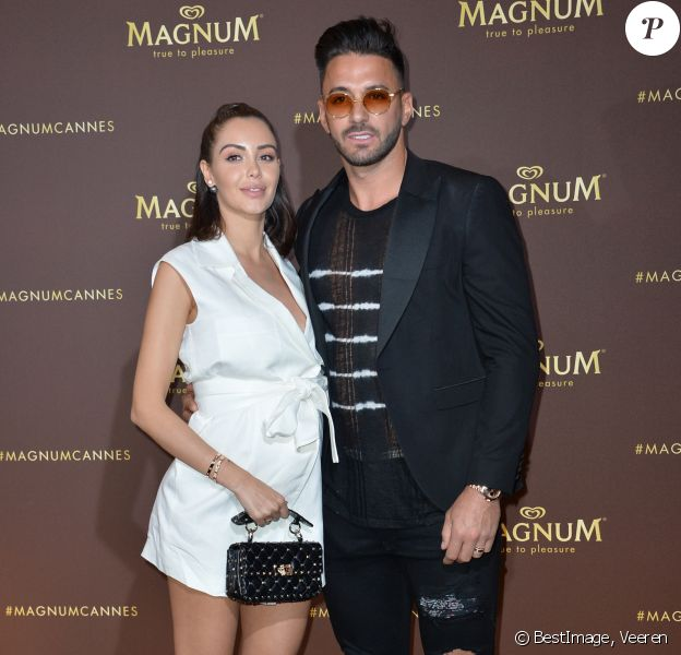 "Nabilla Benattia et son mari Thomas Vergara au photocall de l'after party ""Magnum x Rita Ora"" sur la plage privé Magnum lors du 72e Festival International du Film de Cannes, France,le 16 mai 2019. © Veeren/Bestimage"