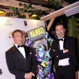 """Sylvester Stallone et Richard Orlinski lors du dîner Millennium Media et du cocktail en l'honneur de Sylvester Stallone, organisé par Five Eyes Production sur la plage La Môme, lors du 72ème Festival International du Film de Cannes. A cette occasion, en hommage à sa carrrière, Richard Orlinski a offert à Sylvester Stallone une édition unique d'une de ses oeuvres, un """"Wild Kong"""" d'une valeur de 80.000 euros. Cannes, le 24 mai 2019. © Rachid Bellak/Bestimage"""