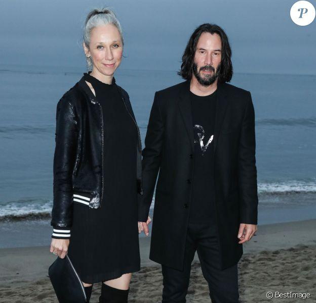 Alexandra Grant et Keanu Reeves assistent au défilé Saint Laurent, collection homme printemps-été 2020 à Malibu. Le 6 juin 2019.