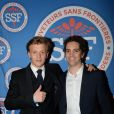 """Alex Lutz et Bruno Sanches - Soirée de gala """"Sauveteurs sans frontières"""" à l'hôtel du collectionneur à Paris le 23 mars 2015."""