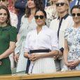 """Catherine (Kate) Middleton, duchesse de Cambridge, Meghan Markle, duchesse de Sussex, et Pippa Middleton dans les tribunes lors de la finale femme de Wimbledon """"Serena Williams - Simona Halep (2/6 - 2/6) à Londres, le 13 juillet 2019. © Ray Tang/London"""