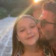 David Beckham pose avec sa fille Harper, en Italie, le 10 août 2019