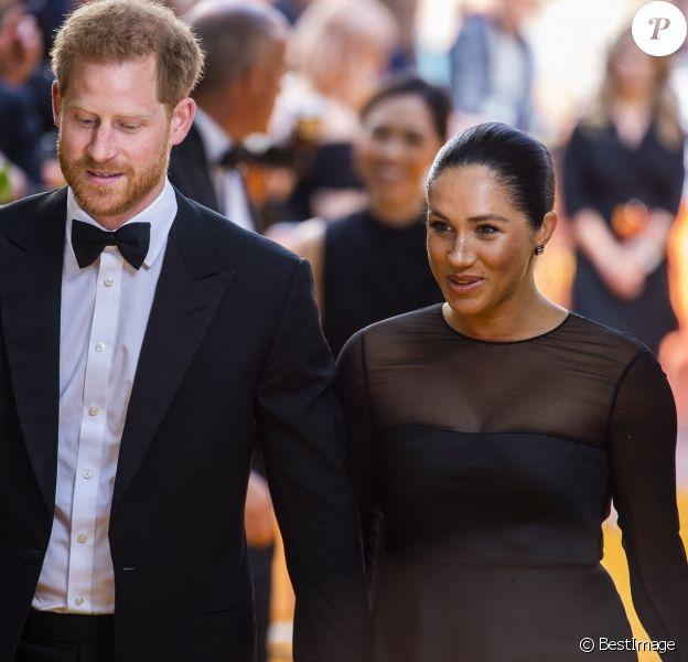 """Le prince Harry et Meghan Markle, duc et duchesse de Sussex, lors de la première du film """"Le Roi Lion"""" au cinéma Odeon Luxe Leicester Square à Londres, le 14 juillet 2019."""