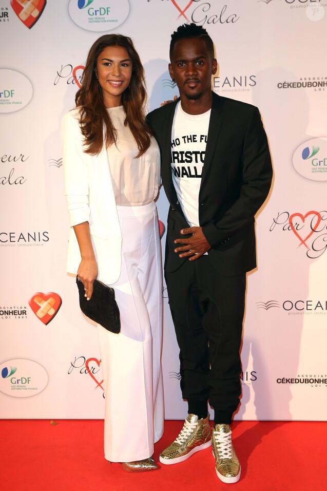 """Black M (Alpha Diallo) et sa femme Lia - Personnalités au gala """"Par Coeur"""" pour les 10 ans de l'association """"Cekedubonheur"""" au pavillon d'Armenonville à Paris. Le 24 septembre 2015"""