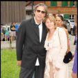 Stéphane Ferrara et sa future femme Dominique Cantien lors de la journée de baptême de Joy à Gstaad en Suisse le 5 juillet 2009