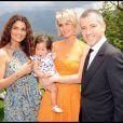 Bruno Putzulu et sa compagne entourant Joy et Laeticia Hallyday lors de la journée de baptême de Joy à Gstaad en Suisse le 5 juillet 2009