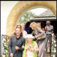 Nikos et la grand-mère de Laeticia Hallyday Eliette lors de la journée de baptême de Joy à Gstaad en Suisse le 5 juillet 2009