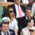Hugh Grant et sa femme Anna Elisabet Eberstein - Les célébrités dans les tribunes de Wimbledon à Londres, le 12 juillet 2019.