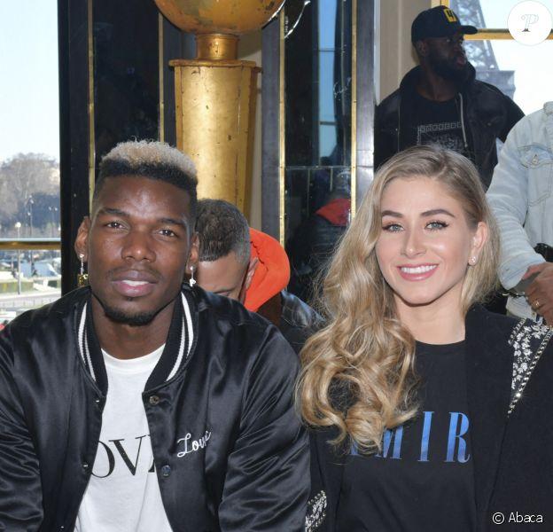 Paul Pogba et sa femme Maria au défilé Amiri lors de la Fashion Week Homme de Paris, automne/hiver 2020-2021 le 16 janvier 2020.