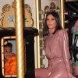 """Kanye West, Kim Kardashian et sa soeur Kourtney emmènent leurs filles North West et Penelope Disick, faire un tour de carrousel au pied de la tour Eiffel après un dîner au restaurant """"Ferdi"""". Pour l'occasion ils ont réservé le carrousel pendant 30 minutes pour la somme de 3000 euros. Ils en ont également profité pour acheter des souvenirs à l'effigie de la tour Eiffel. Paris, le 1er mars 2020."""