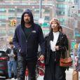 Nicolas Cage et sa compagne Riko Shibata se baladent main dans la main dans le quartier de Manhattan à New York après un diner en amoureux. Le couple s'arrête un moment pour se laver les mains avec un produit hydro-alcooliques. Le 3 mars 2020.