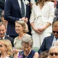 """John Vosler et Emma Watson (habillée en Ralph Lauren) - Les célébrités dans les tribunes lors du tournoi de Wimbledon """"The Championships"""" à Londres, le 14 juillet 2018"""