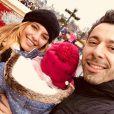 Laetitia Milot avec Badri et leur fille Lyana à Disneyland Paris, le 17 décembre 2018.
