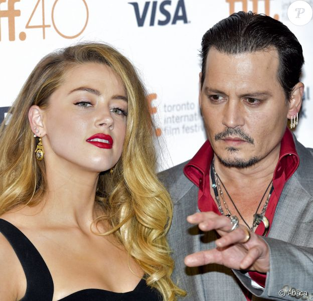 "Amber Heard et Johnny Depp - Photocall du film ""Black Mass"" durant le 72e Festival du film international de Venise. Le 14 septembre 2015. @Nathan Denette/The Canadian Press/ABACAPRESS.COM"