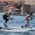 """La princesse Charlene de Monaco, soutenue par son mari le prince Albert, s'entraîne avec le champion de MMA Conor McGregor pour le """"Calvi – Monaco Water bike Challenge"""" qui se tiendra en septembre. Sur Instagram, le 20 juillet 2020."""
