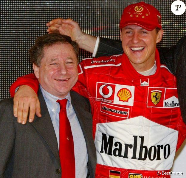 jean Todt, Michael Schumacher, Luca Montezemolo et Rubbens Barrichello à la présentation de la nouvelle Ferrari (2003).