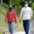 Exclusif - Lily Collins et son compagnon Charlie McDowell promènent leur chien dans les rues de Los Angeles pendant l'épidémie de coronavirus (Covid-19), le 22 juillet 2020