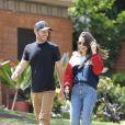 Exclusif - Eclats de rire entre Lily Collins et son compagnon Charlie McDowell pendant leur promenade à Beverly Hills avec leur chien Redford, le 7 avril 2020.