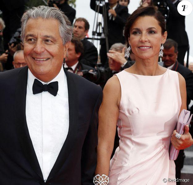 """Christian Clavier et Isabelle De Araujo (Bijoux APM Monaco) - Montée des marches du film """"Jimmy's Hall"""" lors du 67 ème Festival du film de Cannes – Cannes."""