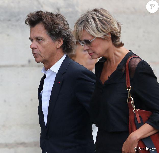 Guy Martin et sa femme Katherina Marx - Obsèques de Mireille Darc en l'église Saint-Sulpice à Paris.