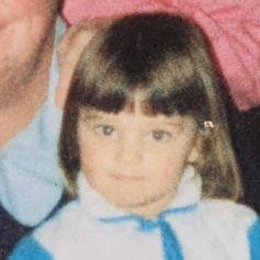 Miranda Kerr, enfant, sur les genoux de son grand-père.