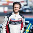 Le prince Carl Philip de Suède participe à la course Porsche Carrera Cup à Mantrop le 15 avril 2021.