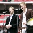 Le prince William et le prince Harry lors du concert hommage à Diana au stade de Wembley, à Londres en 2007.