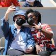 Claudia Tagbo et son compagnon - People dans les tribunes lors des internationaux de France de Tennis de Roland Garros 2021 à Paris, le 6 juin 2021. © Dominique Jacovides/Bestimage