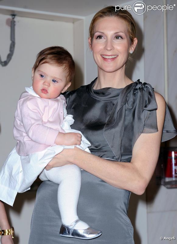 Kelly Rutherford, venue accompagnée de sa petite Helena, 9 mois, lors de la soirée annuelle des Bunny Hop, à New York, le mardi 9 mars.