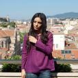 Hafsia Herzi sur la terrasse du showroom Antik Batik, portant le modèle de la marque qu'elle a choisi, à Cannes, en mai 2010.