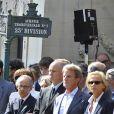 Christophe Girard, Bernard Kouchner et Christine Ockrent lors des obsèques d'Alain Corneau, au cimetière du Père Lachaise, à Paris, le 4 septembre 2010.