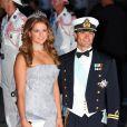 La princesse Madeleine de Suède est apparue lumineuse, rayonannt au bras de son frère le prince Carl Philip, lors du mariage du prince Albert et de la princesse Charlene, à Monaco, le 2 juillet 2011.