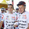 Richard Virenque et Patrick Poivre d'Arvor lors de l'Etape du coeur du  Tour de France, entre Bordeaux et Pauillac, au profit de l'association  Mécénat Chirurgie Cardiaque le 24 juillet 2010
