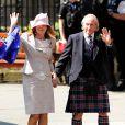 Jackie Stewart et son épouse Alexandra arrivent au mariage de Zara Phillips et de Mike Tindall, à Edimbourg, le 30 juillet 2011.