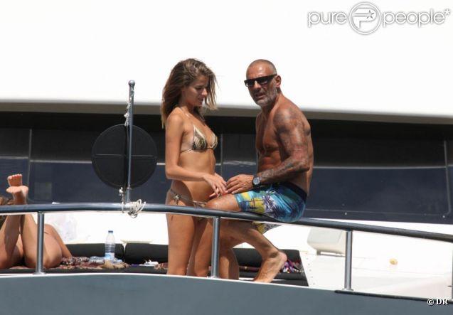 Christian Audigier et sa chérie Nathalie Sorensen en vacances à Ibiza le 30 juillet 2011