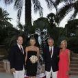 Charlene et Albert de Monaco avec Henri Rey, président du Golf, et son épouse à l'occasion du 100e anniversaire du Golf Club de Monte-Carlo, le 27 août 2011