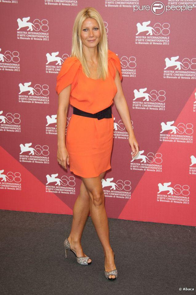 L'actrice Gwyneth Paltrow, rayonnante dans sa robe Prada, lors du photocall du film  Contagion . Venise, le 3 septembre 2011.