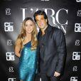 Cristiana Arcangeli et son mari à la soirée organisée par la Brésilienne pour le  lancement de sa   nouvelle gamme de cosmétiques à L'Arc à Paris, le 1e  octobre 2011