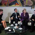 Carla Bruni-Sarkozy, Nicolas Sarkozy, Angela Merkel et Louis Sarkozy en septembre 2010.