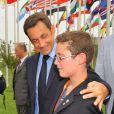 Louis Sarkozy et son papa Nicolas en août 2008.