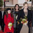 Albert et Charlene de Monaco lors du centenaire de la paroisse Saint-Martin, à Monaco, le 13 novembre 2011. Caroline et Alexandra participent également à l'événement.