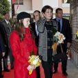 Albert et Charlene de Monaco lors du centenaire de la paroisse Saint-Martin, à Monaco, le 13 novembre 2011. Caroline et Alexandra sont à leurs côtés.
