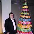 Pierre Hermé pose avec son sapin gourmand pour la 16e édition des Sapins  de Noël des créateurs à l'hôtel de Rothschild le 1er décembre 2011